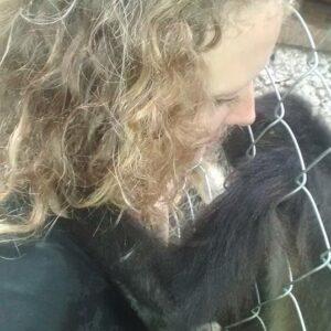 with rescued spider monkey Mathilda