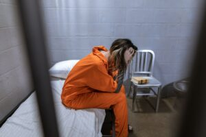 prisoner on bed, dispairing